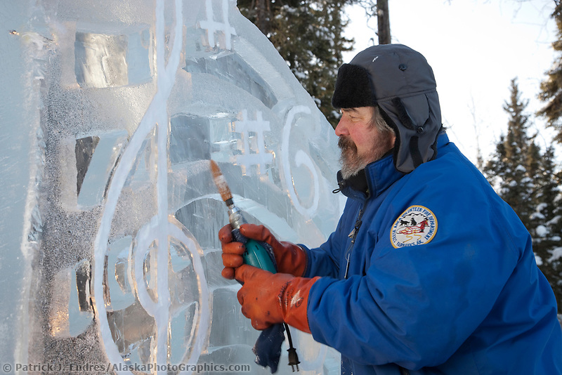"Jim Warner, USA, works on the multi block sculpture titled ""Irish Wedding"" for the 2009 World Ice Art Championships in Fairbanks, Alaska. Team members: Mark Chapin, Mimi Chapin, Jim Warner, Pat Moodie"