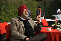 At the wedding ceremony of British/Punjabi couple Lindsay and Navneet Singh at a gurdwara in Amritsar, the father of the groom uses a mobile phone.