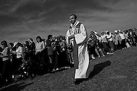A Czech catholic priest walks among believers at the end of the open-air mass served by the Pope Benedict XVI in Stara Boleslav, one of the main pilgrimage site of the Czech Republic, September 28, 2009.