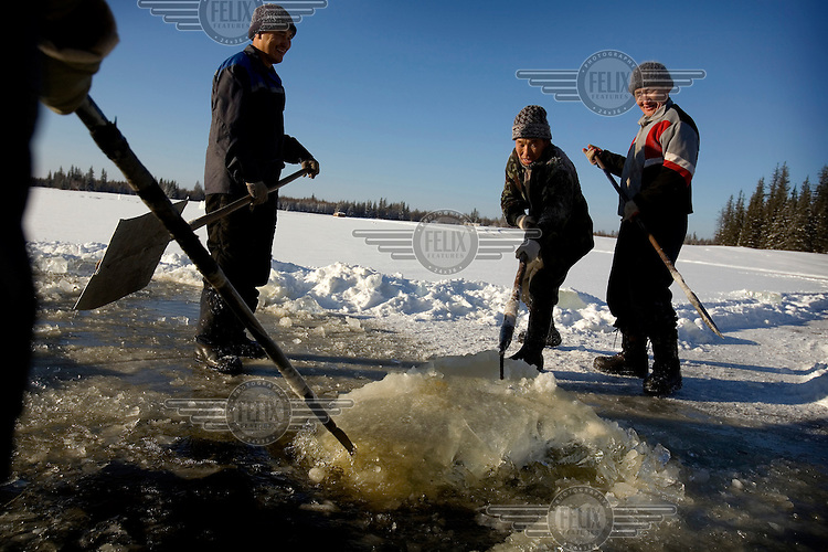 Workers, who are all members of the United Russia Party, collect ice from a lake near the Bedime village in Yakutia. There is no running water in the 600-strong village, and the ice will be transported to the village to be melted for water. .