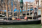 A gondolier docks his gondola in Venice, Italy on the Grand Canal