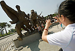 Korean women take photos by the national war memorial after Korean War veterans had attended a commemorative event to mark the 60th anniversary of the start of the Korean War at the National Cemetery in Seoul, South Korea on 23 June, 2010..