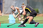 30 August 2014: Wake Forest's Christine Conroe (4) and Iowa's Chandler Ackers (right). The Wake Forest University Demon Deacons played the University of Iowa Hawkeyes at Francis E. Henry Stadium in Chapel Hill, North Carolina as part of the ACC/Big 10 Challenge and an 2014 NCAA Division I Field Hockey match. Iowa won the game 4-1.