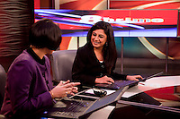 Suhasini Haidar (left) and Anubha Bhonsle (right)anchoring on 8pm Prime on CNN-IBN in Studio 1 on 6th December 2010. Photo by Suzanne Lee