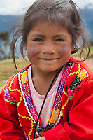 Quechua girl portrait in the countryside near Cusco Peru, South America