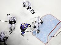 San Antonio Rampage goaltender Dov Grumet-Morris (1) makes a save on Peoria Rivermen's Josh Lunden (33) during an AHL hockey game, Saturday, Jan. 21, 2012, in San Antonio. (Darren Abate/pressphotointl.com)