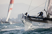 Extreme Sailing Series 2011. Leg 1. Muscat. Oman.Day 2 of racing. Groupe Edmond De Rothschild skippered by Pierre Pennec with team mates Christophe Espagnon,Thierry Fouchier and Herve Cunningham..