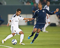 CARSON, CA – May 14, 2011: LA Galaxy defender AJ DeLaGarza (20) attempts to get a pass by Sporting KC forward Teal Bunbury (9) during the match between LA Galaxy and Sporting Kansas City at the Home Depot Center in Carson, California. Final score LA Galaxy 4, Sporting Kansas City 1.
