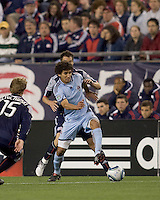 Colorado Rapids midfielder Mehdi Ballouchy (8) collects the ball as New England Revolution midfielder Marko Perovic (29) is unable to control a pass. The Colorado Rapids defeated the New England Revolution, 2-1, at Gillette Stadium on April 24, 2010.