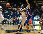 Ole Miss' Jarvis Summers(32) vs. SMU's Jeremiah Samarrippas (12) at the C.M. &quot;Tad&quot; Smith Coliseum in Oxford, Miss. on Tuesday, January 3, 2012. Ole Miss won 50-48.