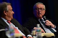 """Washington, DC - April 21, 2017: European Commission President Jean-Claude Juncker speaks at the""""Financing for Peace"""" panel discussion during the annual Spring Meetings of the IMF/World Bank Group at the IMF headquarters in the District of Columbia April 21, 2017, as United Nations Secretary General Antonio Guterres looks on. (Photo by Don Baxter/Media Images International)"""
