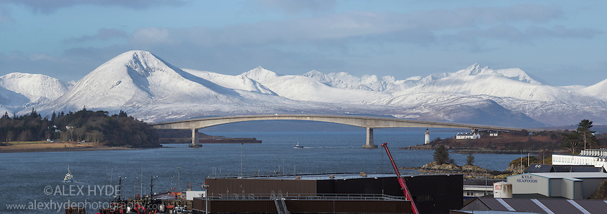 The Skye Bridge viewed from Kyle of Lochalsh with the snow-covered Cullins in the background, Scotland. March. Digitally stitched panorama.
