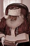 Santa Claus reading a large book