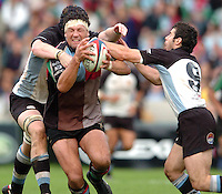2005/06 National League One, NEC Harlequins vs Exeter, Twickenham Stoop, Twickenham, ENGLAND: Quins Andre Vos it tackle by Richard Baxter [behind] and Kevin Barrett from the right.   22.10.2005   © Peter Spurrier/Intersport Images - email images@intersport-images..   [Mandatory Credit, Peter Spurier/ Intersport Images].