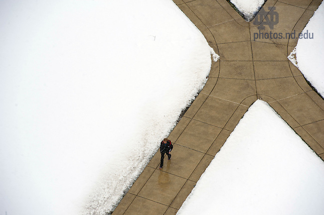 December 9, 2011; A student walks through north quad. Photo by Barbara Johnston/University of Notre Dame.