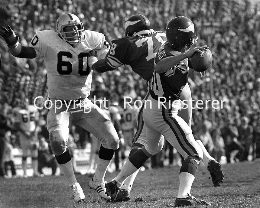 Oakland Raider lineman Otis Ssistrunk after Vikings quarterback Fran Tarkenton in the 1977 Superbowl.<br />(photo by Ron Riesterer)