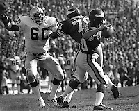 Oakland Raider lineman Otis Ssistrunk after Vikings quarterback Fran Tarkenton in the 1977 Superbowl.<br />