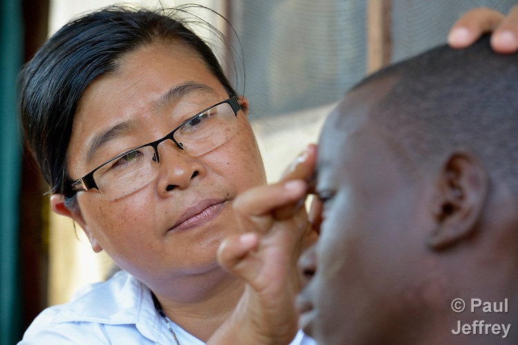Sister Joana Mai Hla Kyi, a member from Myanmar of the Sisters of Our Lady of the Missions, applies ointment to the face of a boy in Riimenze, South Sudan. The health worker is a member of Solidarity with South Sudan, a pastoral and teaching presence of Catholic priests, sisters and brothers from around the world.