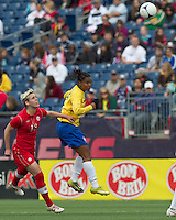 Brazilian midfielder Renata Costa (9) heads the ball. In an international friendly, Canada defeated Brasil, 2-1, at Gillette Stadium on March 24, 2012.