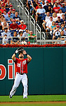 9 July 2011: Washington Nationals outfielder Laynce Nix pulls in a fly ball to left field by the Colorado Rockies at Nationals Park in Washington, District of Columbia. The Nationals were edged out by the Rockies 2-1, dropping the second game of their 3-game series. Mandatory Credit: Ed Wolfstein Photo