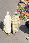 Two men walk through the market in Marrakesh, Morocco.