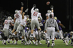 "The Washington State defensive front, Andy Mattingly (#45), Casey Hamlett (#96), Bernard Wolfgramm (#95), Anthony Laurenzi (#61) and Travis Long (#89), go sky-high to try to block a field goal attempt during the Cougars Pac-10 conference ""Apple Cup"" showdown with arch-rival Washington at Husky Stadium in Seattle, Washington, on November 28, 2009.  The Cougars lost to the Huskies in the game, 30-0."