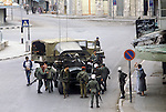 Nablus West Bank Israel. Israeli soldiers lead Palestinian man away ( in brown jacket left of image) Palestinian women remonstrate with soldiers. 1980s Middle East