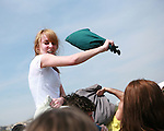 A participant in International Pillow Fight Day  attacks from the air on the National Mall in Washington, DC on Saturday, April 3, 2010.