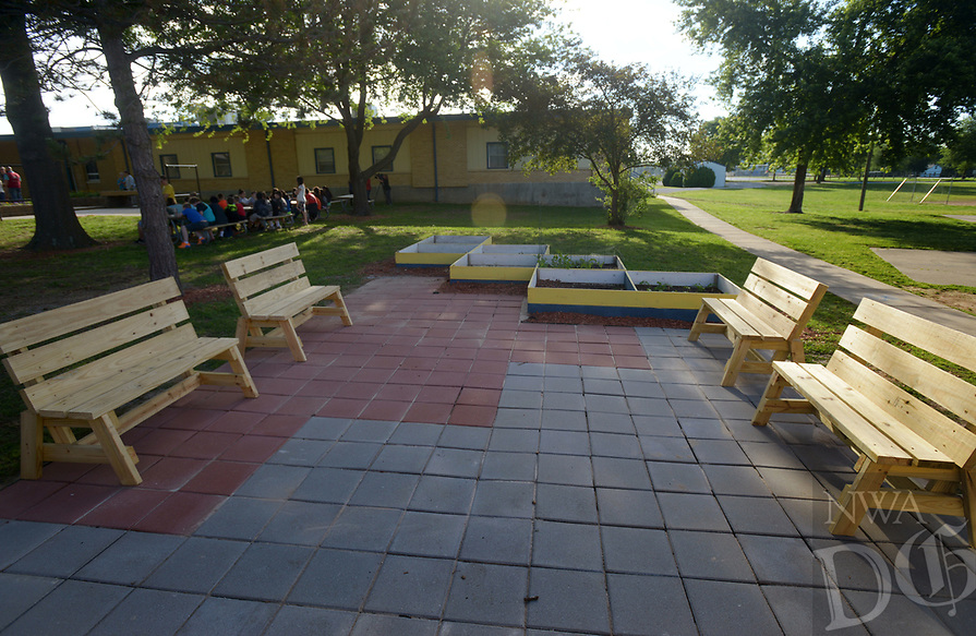 NWA Democrat-Gazette/BEN GOFF @NWABENGOFF<br /> Benches and planter beds built by local Eagle Scouts complement the outdoor classroom Monday, May 15, 2017 during a ribbon-cutting for the new outdoor classroom at Northside Elementary School in Rogers. The school took the oportunity to thank the Rogers Public Education Foundation and local businesses including Lowe's Home Improvement, Milestone Construction Company and Gall Excavation Inc. which made the project possible. The outdoor classroom was complemented by raised planting beds and benches made by local Eagle Scouts, and a butterfly garden built by teachers.