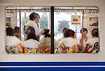 Kimono-clad woman on a train in Tokyo Japan. Photographer: Robert Gilhooly