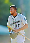30 June 2012: Vermont Lake Monsters infielder John Wooten returns to the dugout during a game against the Lowell Spinners at Centennial Field in Burlington, Vermont. Mandatory Credit: Ed Wolfstein Photo