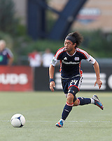 New England Revolution midfielder Lee Nguyen (24) brings the ball forward. In a Major League Soccer (MLS) match, New England Revolution defeated New York Red Bulls, 2-0, at Gillette Stadium on July 8, 2012.