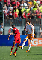 28 July 2012: Houston Dynamo defender Bobby Boswell #32 and Toronto FC foward/midfielder Ryan Johnson #9 in action during an MLS game between Toronto FC and the Houston Dynamo at BMO Field in Toronto,Ontario Canada..The Houston Dynamo won 2-0...