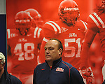 Ole Miss assistant coach Keith Burns listens as football coach Houston Nutt speaks at a news conference Monday Nov. 7, 2011 at the University of Mississippi in Oxford, Miss. Nutt will resign at the end of the season.