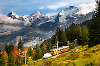 Murren Train with The Eiger 9Left) Monch (middle) & Jungrau (left) - Alps Switzerland