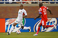 7 June 2011: Guadeloupe midfielder Gregory Gendrey (14) dribbles the ball at Panama defender Felipe Baloy (23) during the CONCACAF soccer match between Panama and Guadeloupe at Ford Field Detroit, Michigan.