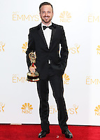 LOS ANGELES, CA, USA - AUGUST 25: Actor Aaron Paul, winner of Outstanding Drama Series Award and Outstanding Supporting Actor in a Drama Series Award for 'Breaking Bad' poses in the press room at the 66th Annual Primetime Emmy Awards held at Nokia Theatre L.A. Live on August 25, 2014 in Los Angeles, California, United States. (Photo by Celebrity Monitor)