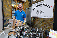 "Noah Fisher, owner of Mamachari Bikes, Dalston, London, UK, March 29, 2014.  Mamachari sells Japanese ""mamachari"" shopping bikes in the East End of London."
