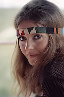 Seventies fashion with Indian-style headband. March 1970. Photo by John G. Zimmerman.