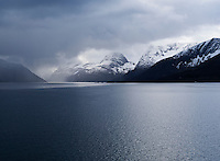 Spring snow storm over coastal mountains in arctic norway