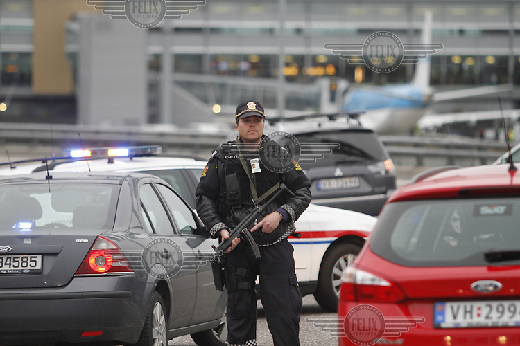 (Oslo July 22, 2011)A police  man a check point by Gardermoen Airport, north of Oslo. A large vehicle bomb was detonated near the offices of Norwegian Prime Minister Jens Stoltenberg on 22 July 2011. Although Stoltenberg was reportedly unharmed the blast resulted in several injuries and deaths. <br /> Another terrorist attack took place shortly afterwards, where a man killed over 80 children and youths attending a political camp at Ut&oslash;ya island. <br /> Anders Behring Breivik was arrested on the island and has admitted to carrying out both attacks.<br /> (photo:Fredrik Naumann/Felix Features)