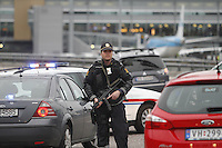(Oslo July 22, 2011)A police  man a check point by Gardermoen Airport, north of Oslo. A large vehicle bomb was detonated near the offices of Norwegian Prime Minister Jens Stoltenberg on 22 July 2011. Although Stoltenberg was reportedly unharmed the blast resulted in several injuries and deaths. <br />