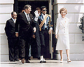 Pop singer Michael Jackson, center, waves as he and United States President Ronald Reagan, left, and first lady Nancy Reagan, right, arrive at the White House ceremony to launch the Campaign against Drunk Driving in Washington, DC on May 14, 1984.<br /> Credit: Ron Sachs / CNP