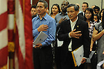 Braulio Ramon (left) and Shengkun Wen become United States citizens during a naturalization ceremony in federal court in Oxford, Miss. on Friday, June 29, 2012. Forty seven persons took the oath of citizenship.