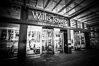 Chicago Willis Tower (Sears Tower) sign in black and white. Willis Tower is the tallest building in Chicago and is one of the tallest skyscrapers in the world.