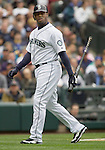 Seattle Mariners Ken Griffey, Jr., walks back to the team dugout after striking out in the game against the  Oakland Athletics in the opening home game of the season at SAFECO Field in Seattle April 12, 2010. The Athletics beat the Mariners 4-0. Jim Bryant Photo. &copy;2010. ALL RIGHTS RESERVED.
