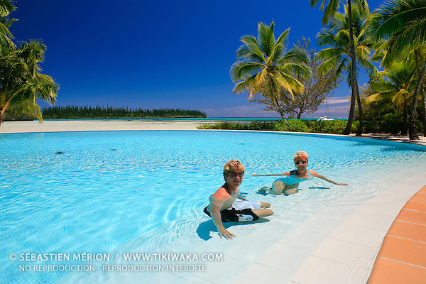talents relaxing in the pool of le m 233 ridien hotel in front of oro bay isle of pines new