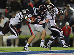 Mississippi quarterback Bo Wallace (14) scores on a 14 yard run against Texas A&amp;M defensive back Deshazor Everett (29) and Texas A&amp;M defensive back Tramain Jacobs (7) in Oxford, Miss. on Saturday, October 6, 2012. (AP Photo/Oxford Eagle, Bruce Newman)..