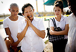 Mourners pay their respects at a prayer ceremony at the Diamond Gate bridge for the hundreds that were killed and injured from a massive stampede on the bridge on the last day of the Water Festival, in Phnom Penh, on Thursday, Nov. 24, 2010.