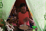 Antia Ferrera Lasala, from La Cerca, prepares rice. The grain is the Dominican Republic's staple food and large part of the country's rice fields are in the Cibao Valley, downstream from the mine. Barrick and Goldcorp's Pueblo Viejo open-pit gold mine threatens the Cibao Valley's agricultural crops, including rice. Cotuí, Sánchez Ramírez, Dominican Republic. April 2012.